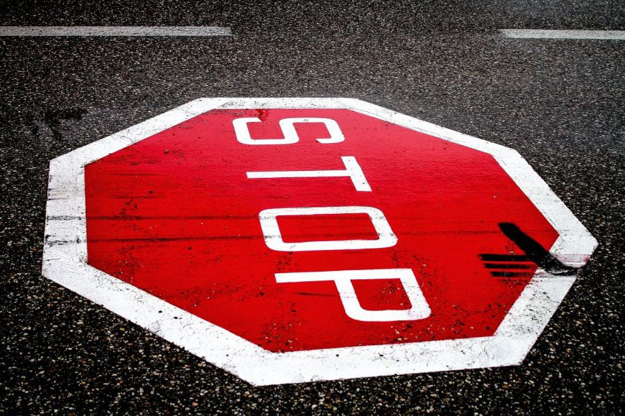 "Traffic ""Stop"" sign painted on road"